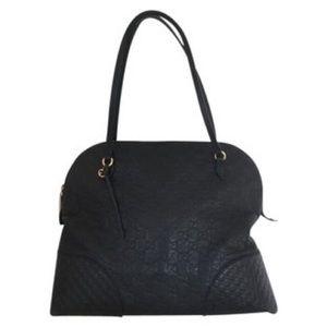 Gucci monogramed black leather, zip closure, gold